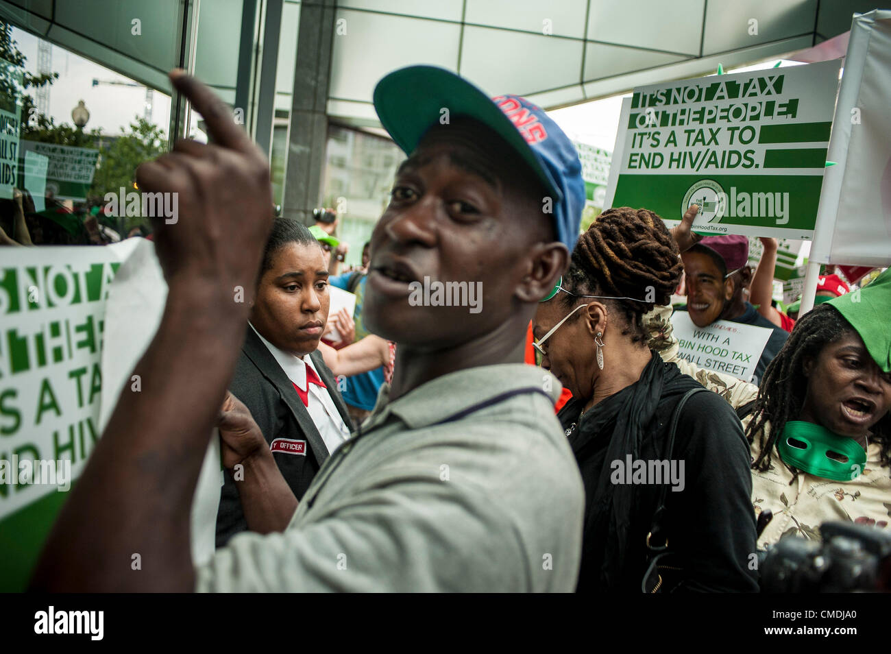 July 24, 2012 - U.S. - A security guard looks on as she guards the door at an office building that activists stopped - Stock Image