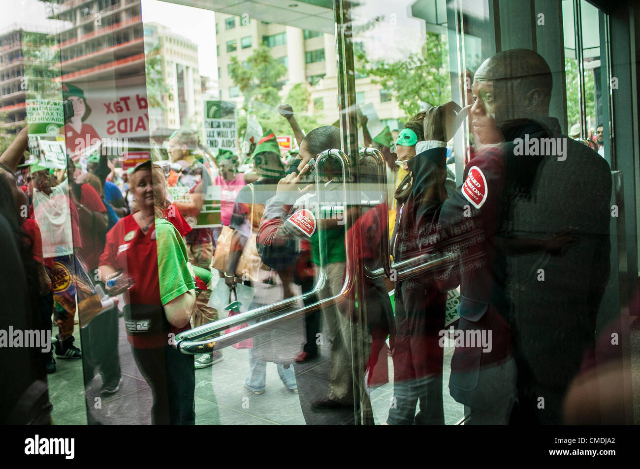 July 24, 2012 - U.S. - A security guard looks on as he guards the door at an office building that activists stopped - Stock Image