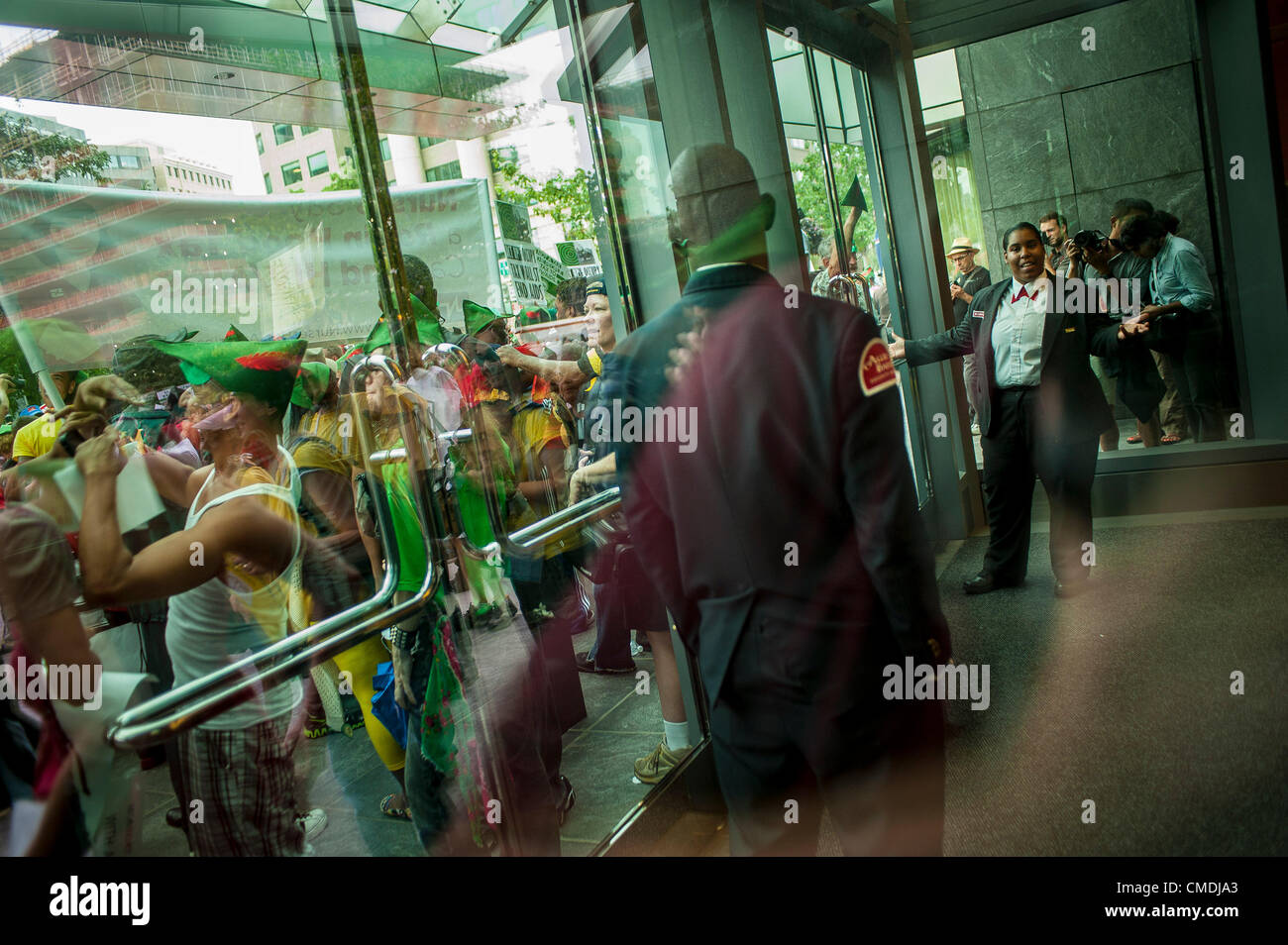 July 24, 2012 - U.S. - Security guards look on and guards the door at an office building that activists stopped - Stock Image