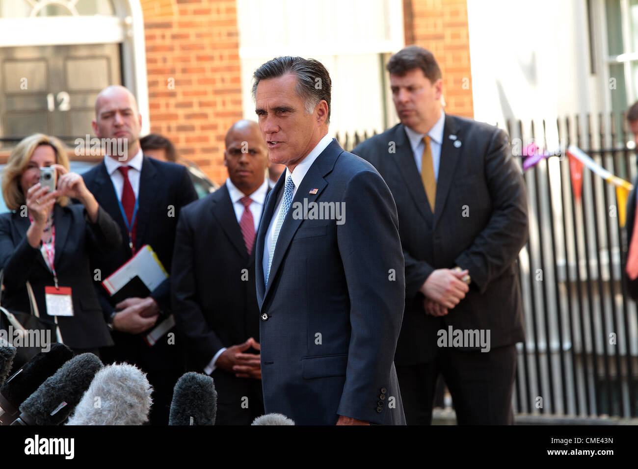 US Republican presidential candidate Mitt Romney addresses American media outside Number 10 Downing Street in London - Stock Image