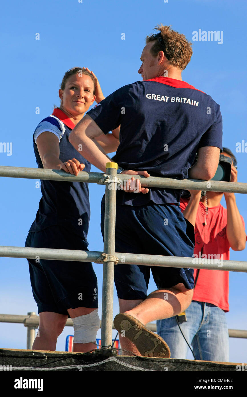 A relaxed Paul Goodison and Bryony Shaw of Team GB in the Sailing Event at Weymouth on the opening night of the Stock Photo