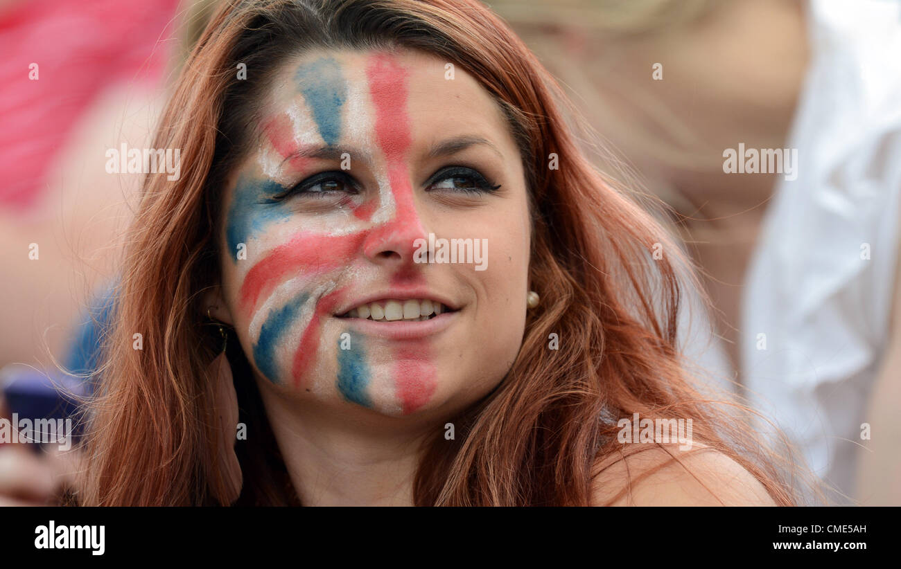 28.07.2012. London, England.  A british eventing fan coloured half her face with a Union Jack at the olympic equestrian - Stock Image