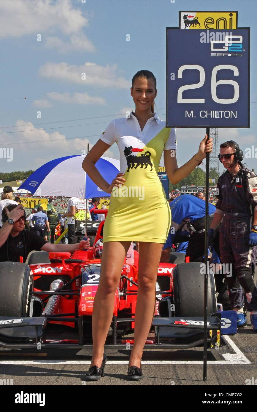 """28.07.2012. Budapest, Hungary. FIA GP2  Motor racing.  Max Chilton on the start line with his """"grid girl"""" - Stock Image"""