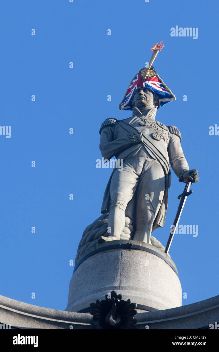 London, England, UK. Monday, 30 July 2012. Lord Nelson Union Flag and torch makeover by Lock & Co., the oldest - Stock Image