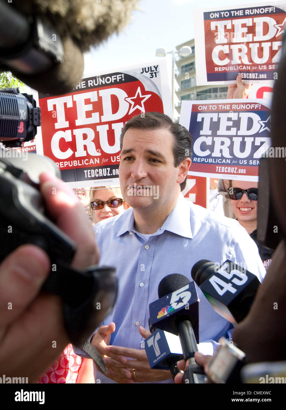 Tea Party US Senate candidate Ted Cruz greets supporters and the press outside a polling place in Houston July 31, Stock Photo