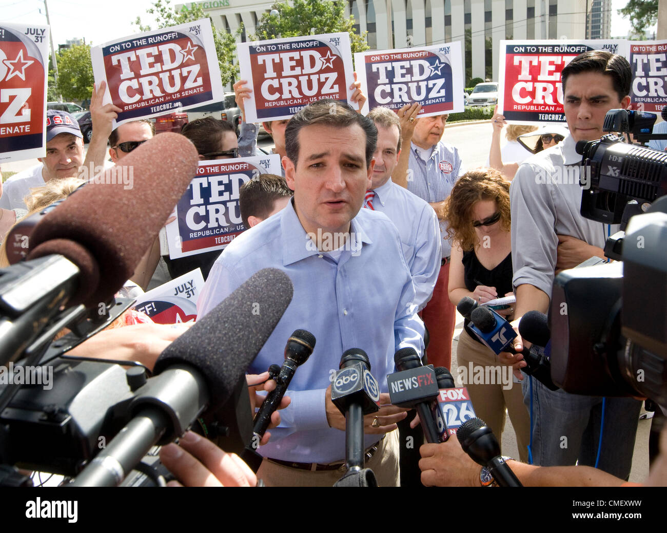 Tea Party US Senate candidate Ted Cruz greets supporters and the press outside a polling place in Houston July 31, - Stock Image