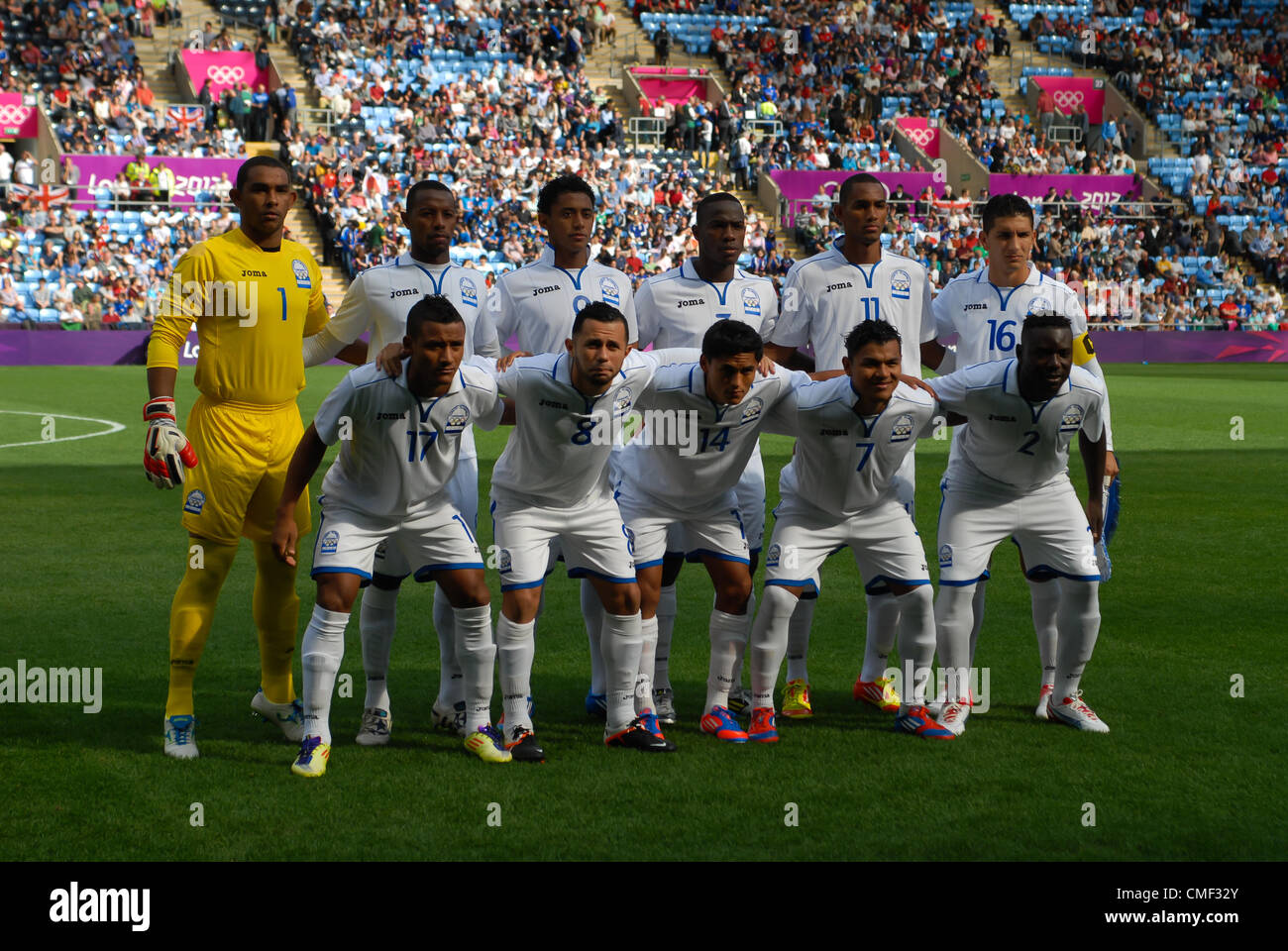 01.08.2012 Coventry, England. Japanese and Honduras Team Line outs before the Olympic Football Men's Preliminary - Stock Image