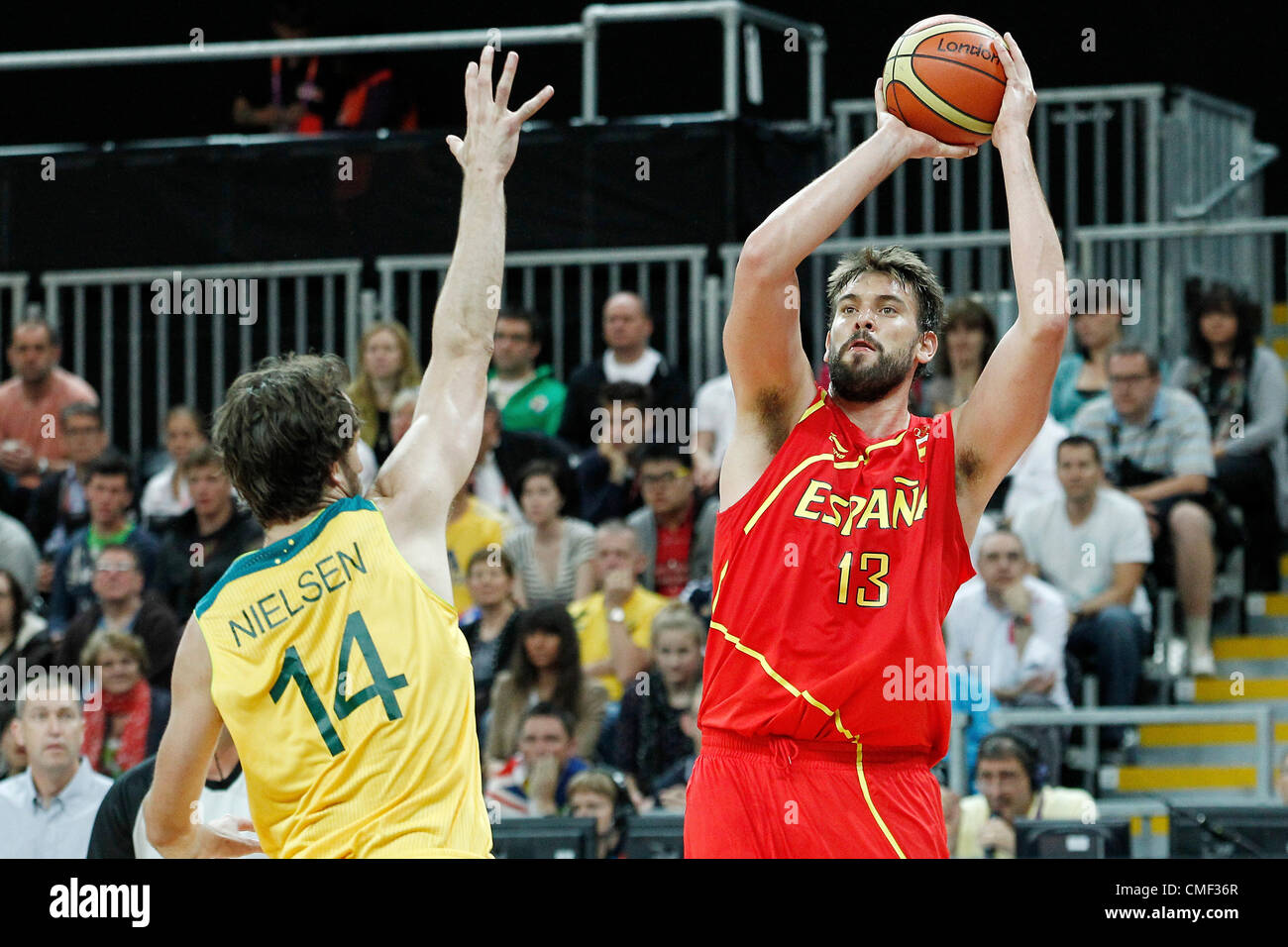 31.07.2012. London, England. Spain Marc Gasol takes a jumpshot over Australia Matt Nielsen during the first half - Stock Image