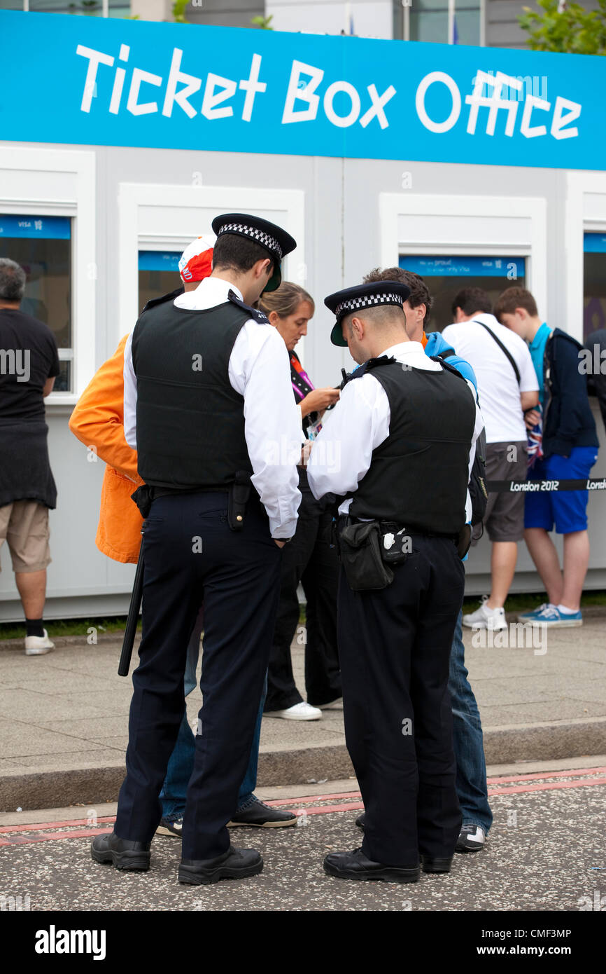 London, UK. Wednesday 1st August 2012. Police assist the queues of London Olympic Games 2012 spectators at ExCel Stock Photo
