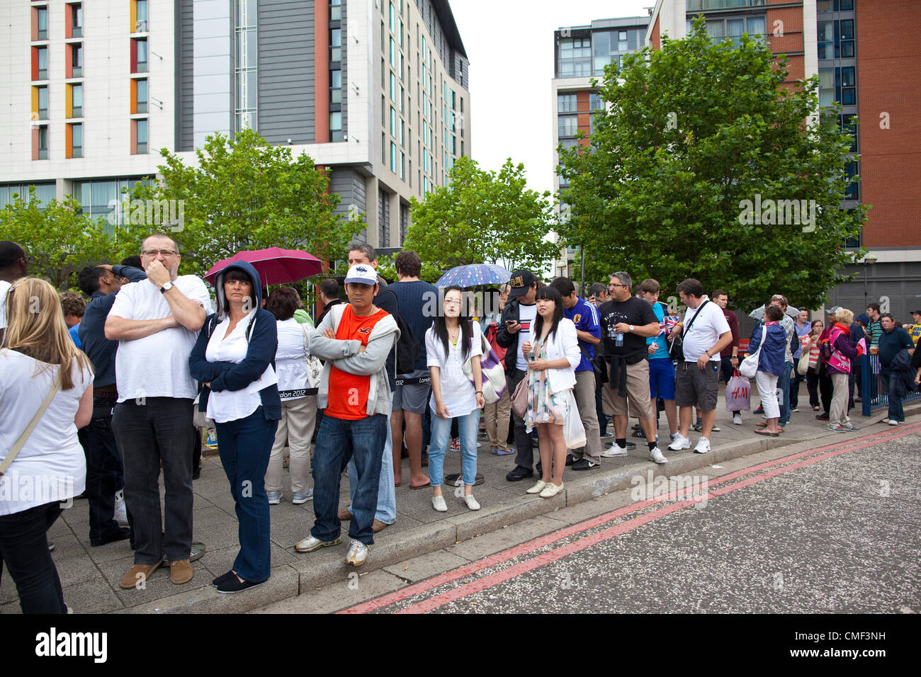 London, UK. Wednesday 1st August 2012. Queues of London Olympic Games 2012 spectators at ExCel Ticket Box Office Stock Photo