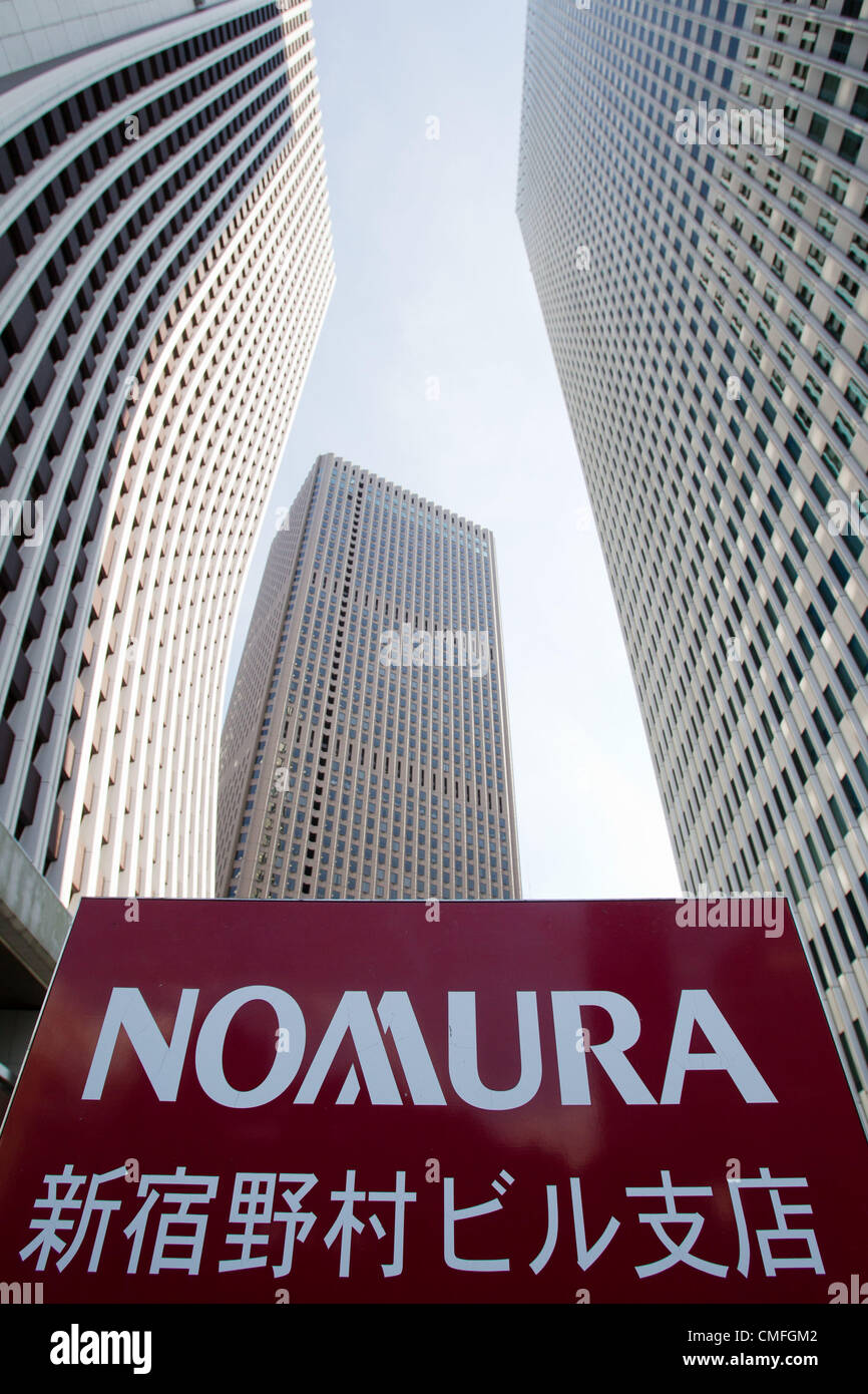 August 3, 2012 - Tokyo, Japan - The Shinjuku building of Nomura Holdings Inc. (right) is seen in downtown Tokyo. Stock Photo