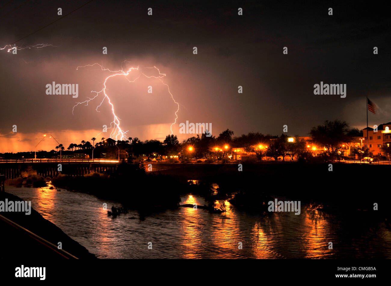 Lightning strikes during a monsoon downpour that fills the Rillito River at North Campbell Avenue on August 5, 2012, Stock Photo