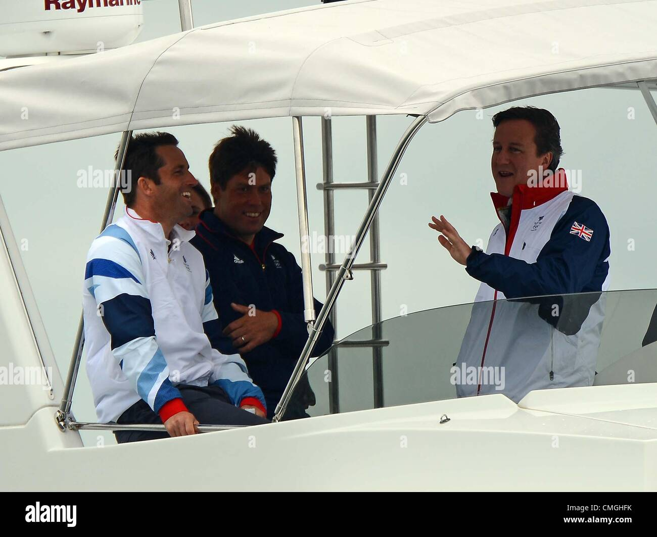 7th Aug 2012. Olympic Sailing, Prime Minister David Cameron visits London 2012 Olympic Games at the Weymouth & Portland Venue, Dorset, Britain, UK.  Seen here watching the RS:X with Gold medal winner in the Finn class Ben Ainslie August 7th, 2012 PICTURE: DORSET MEDIA SERVICE Stock Photo