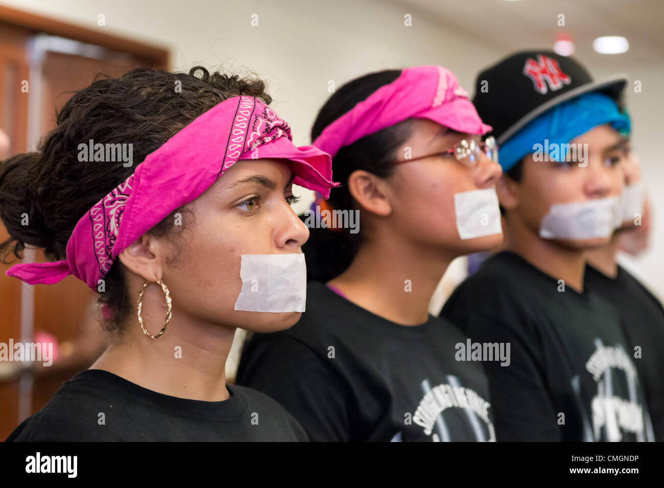 AUGUST 6, 2012 - Mineola, New York, U.S. - At Nassau County Legislature meeting, protesters from Strong Youth Inc - Stock Image