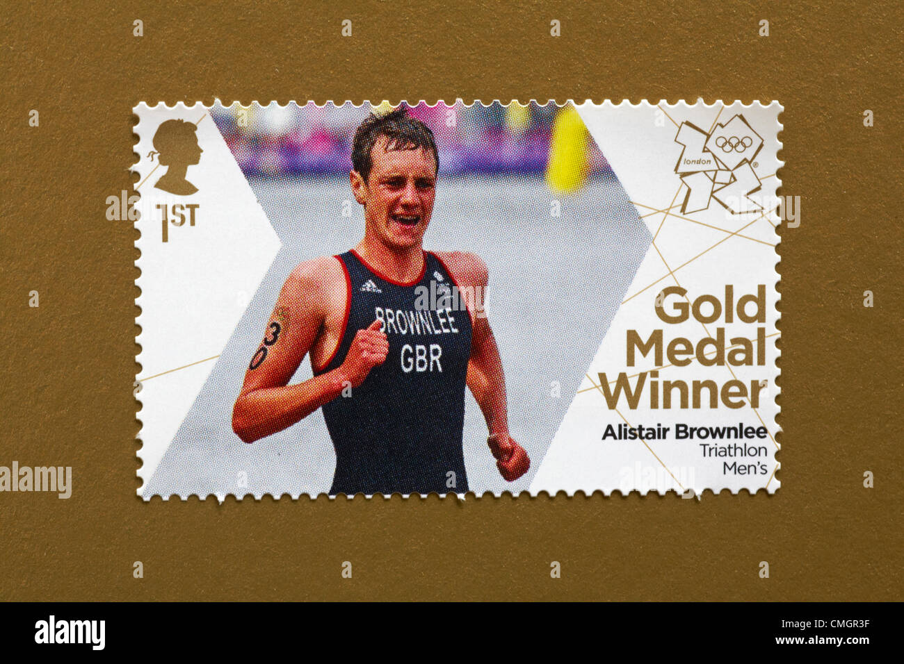UK Wednesday 8 August 2012. Stamp to honour gold medal winner Alistair Brownlee in the Triathlon Men's event. - Stock Image