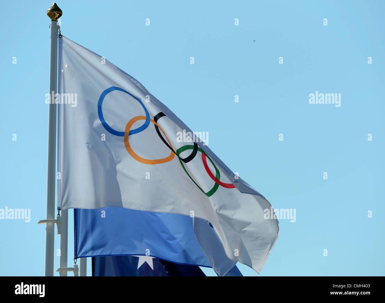 Olympic flag flying alongside flags of the competing nations, 2012 Olympic Games, UK - Stock Image