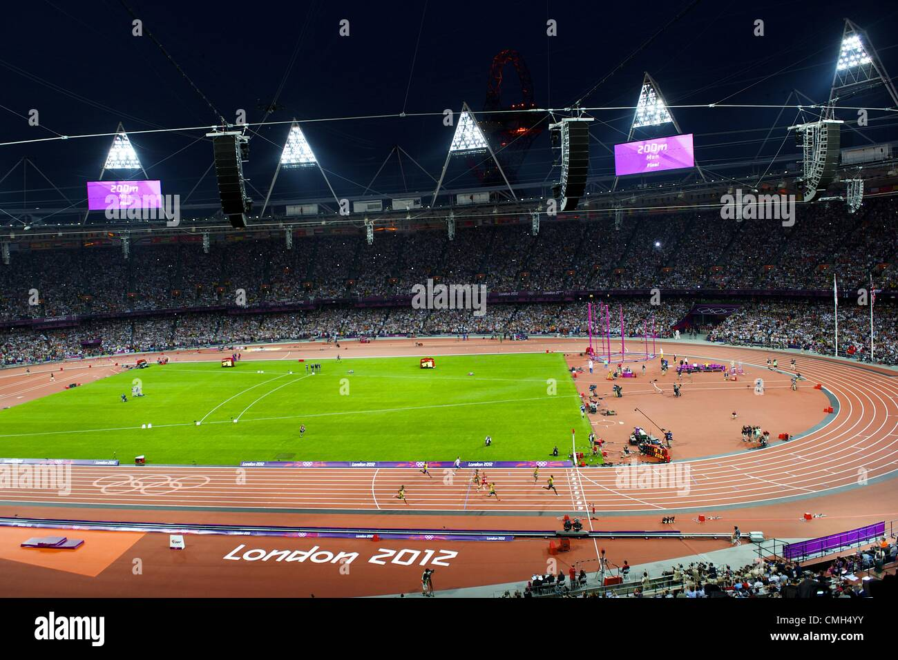 Aug. 9, 2012 - London, England, United Kingdom - Jamaican sprinter USAIN BOLT nears the finish line for a gold medal - Stock Image