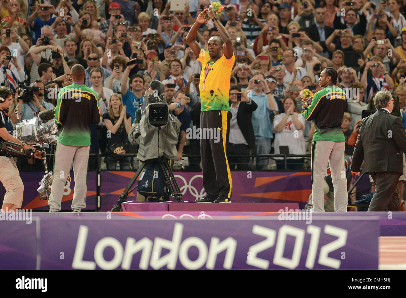 LONDON, ENGLAND - AUGUST 9, Usain Bolt of Jamaica acknowledges the crowd after receiving how gold medal for the - Stock Image