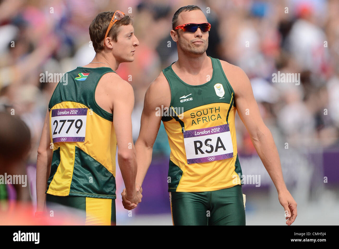 LONDON, ENGLAND - AUGUST 9, Oscar Pistorius of South Africa is consoled by Willem De Beer after Ofentse Mogowane - Stock Image