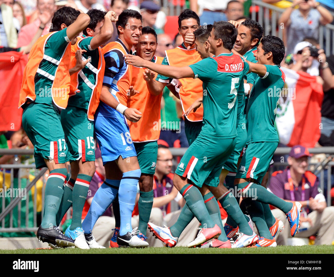 11th Aug 2012. 11.08.2012. Wembley Stadium, London, England.  Team members of Mexico celebrate the first goal for - Stock Image