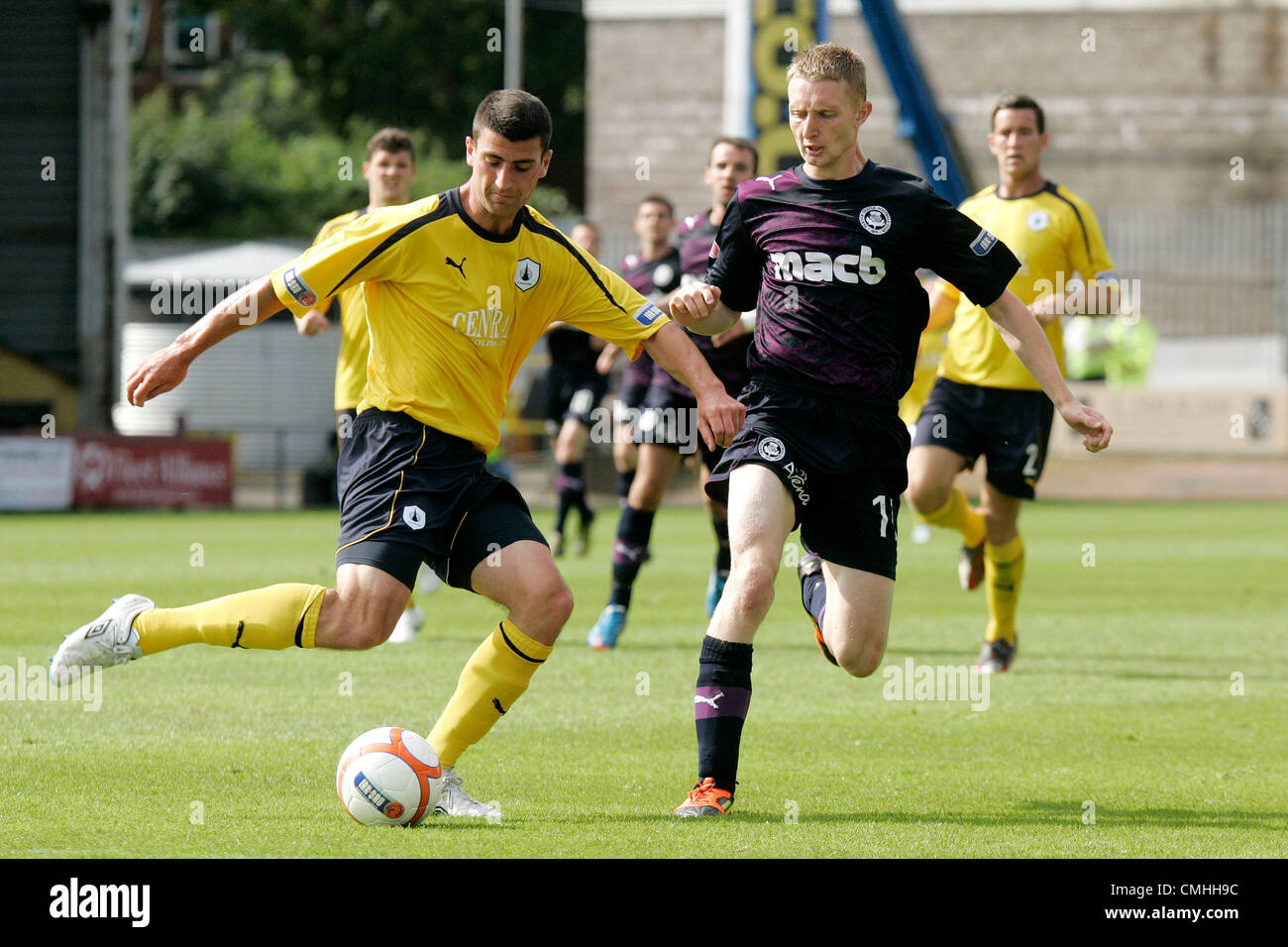 11th Aug 2012. 11.08.2012 Glasgow, Scotland. 11 Chris Erskine and 4 Jonny Flynn in action during the Scottish Football - Stock Image