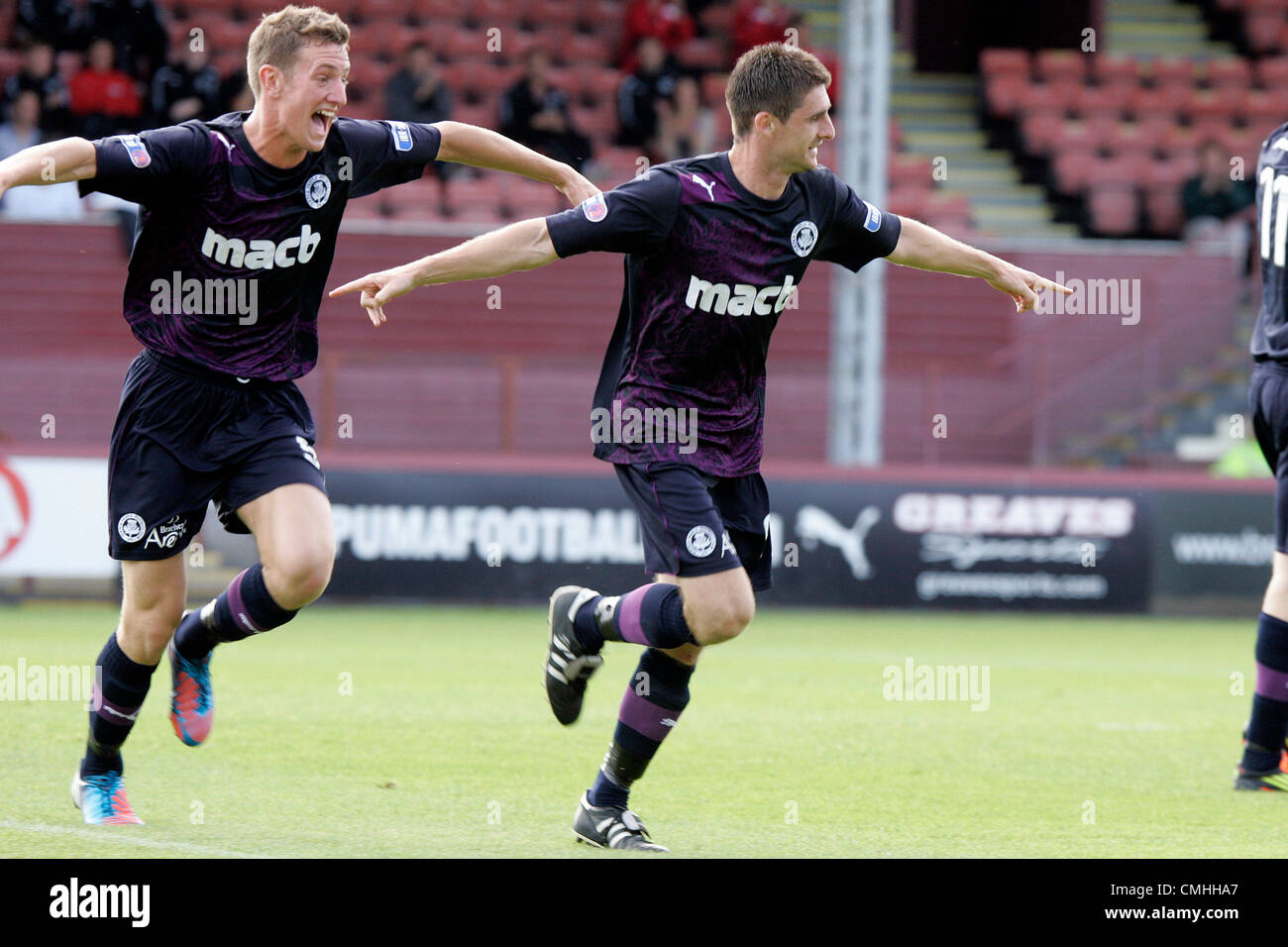 11th Aug 2012. 11.08.2012 Glasgow, Scotland. 9 Kris Doolan celebrates with 5 Aaron Muirhead after the 3rd goal during - Stock Image