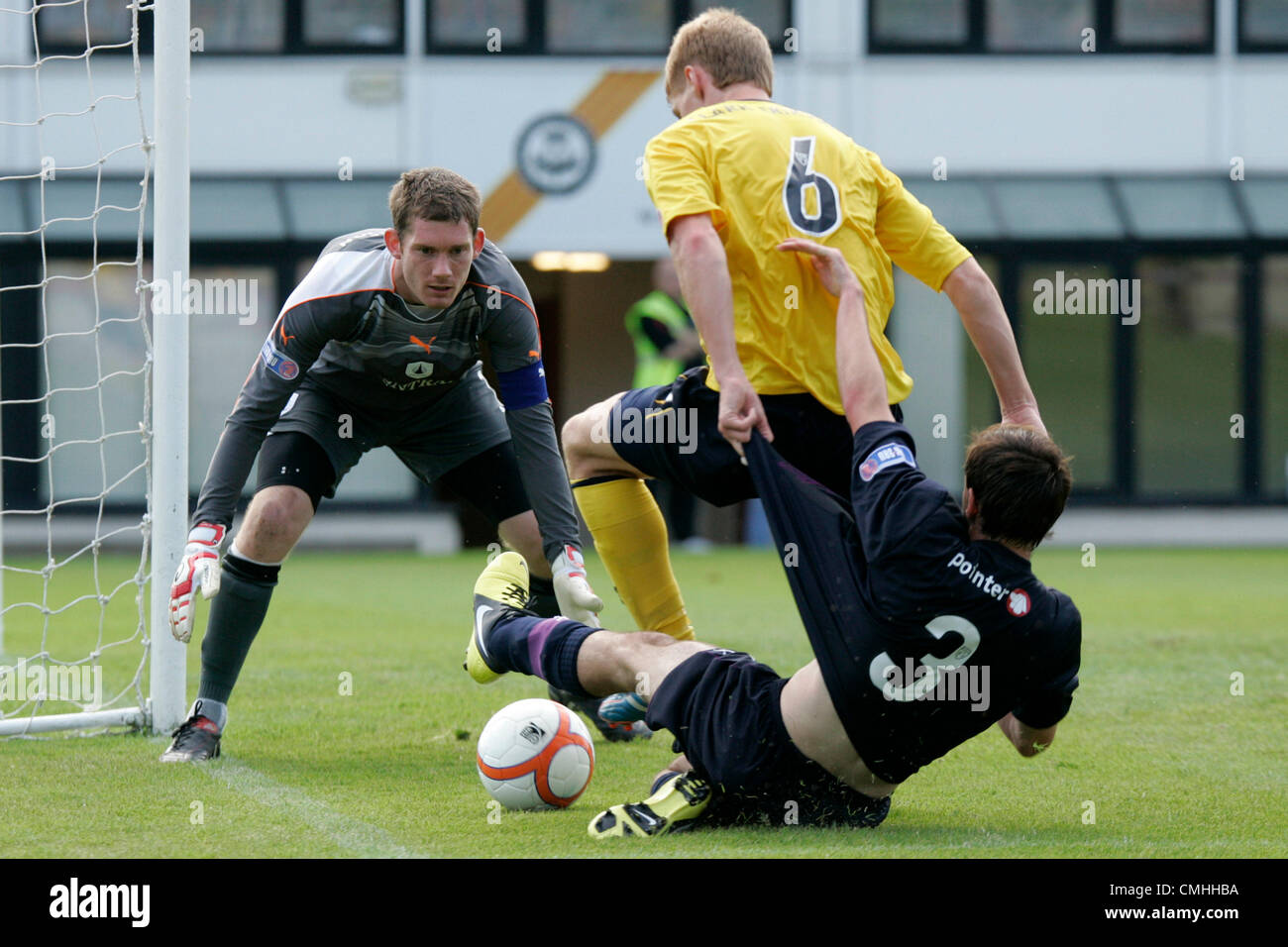 11th Aug 2012. 11.08.2012 Glasgow, Scotland. 3 Stewart Bannigan, 1 Michael McGovern and 6 Jay Fulton in action during - Stock Image