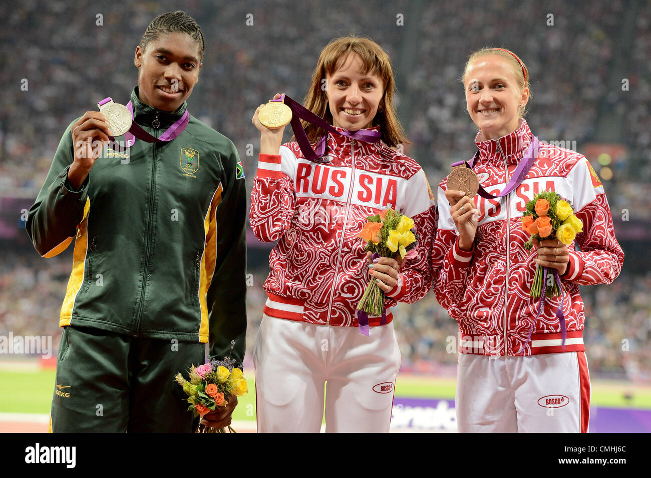 LONDON, ENGLAND - AUGUST 11, Caster Semenya of South Africa, Mariya Savinova and Ekaterina Poistogova of Russia - Stock Image