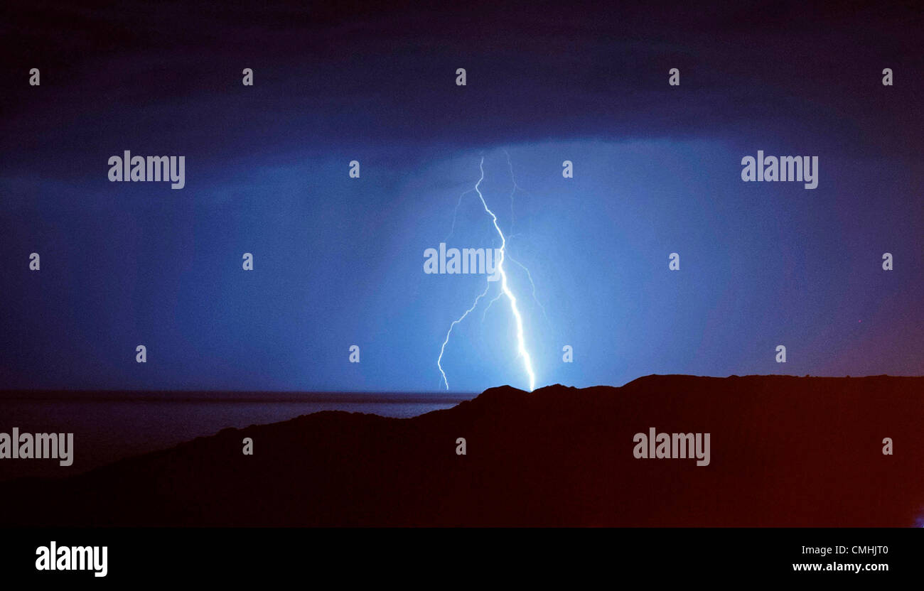 Gower Peninsula, Swansea, UK - Saturday 11th August 2012 (11pm). Thunder and lightning storm over Langland Bay Golf Stock Photo