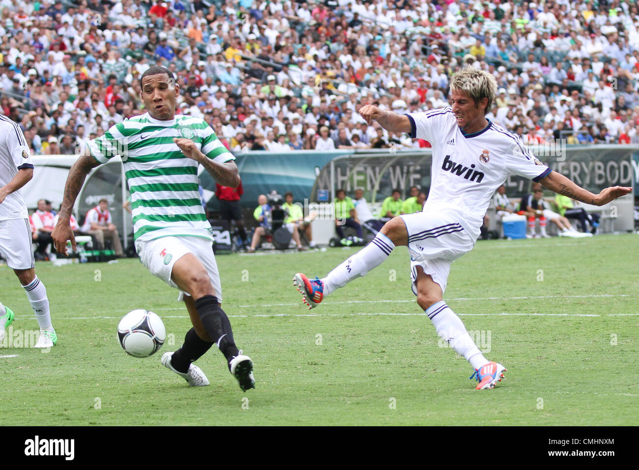 11.08.2012. Philadelphia, USA.  Real Madrid midfielder Fabio Coentrao (15) kicks the ball past Celtic FC defender Stock Photo