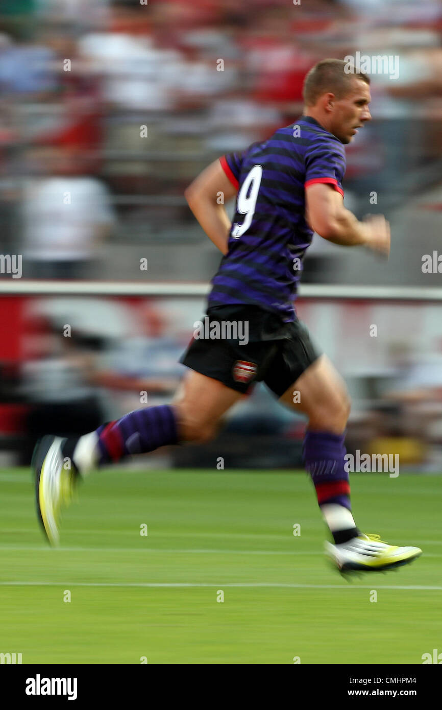 12.08.2012. Cologne, Germany.  Arsenal's Lukas Podolski plays the ball preseaon friendly match between FC Cologne - Stock Image
