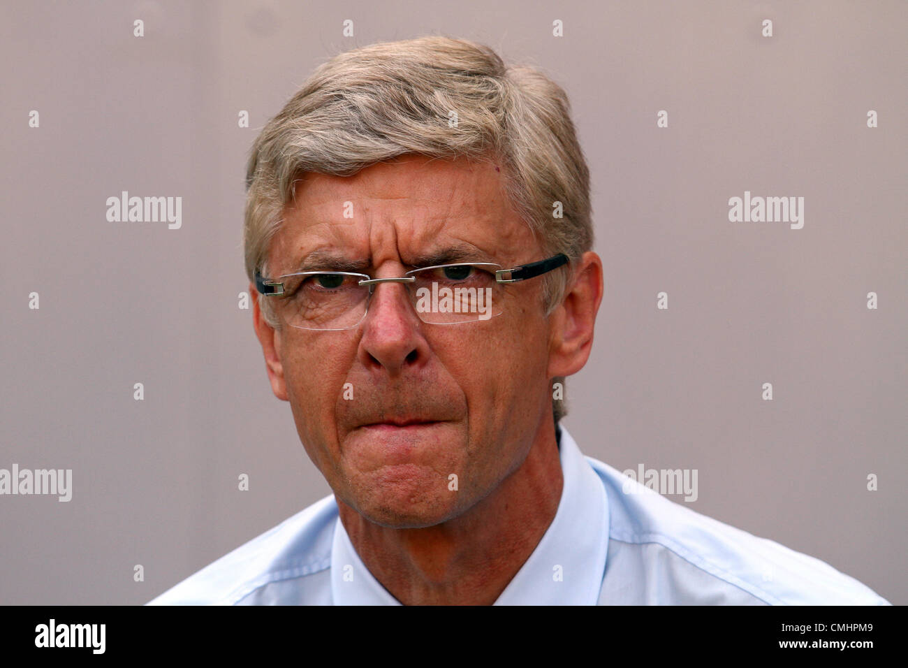 12.08.2012. Cologne, Germany.  Arsenal's head coach Arsene Wenger gives an interview before the preseaon friendly - Stock Image