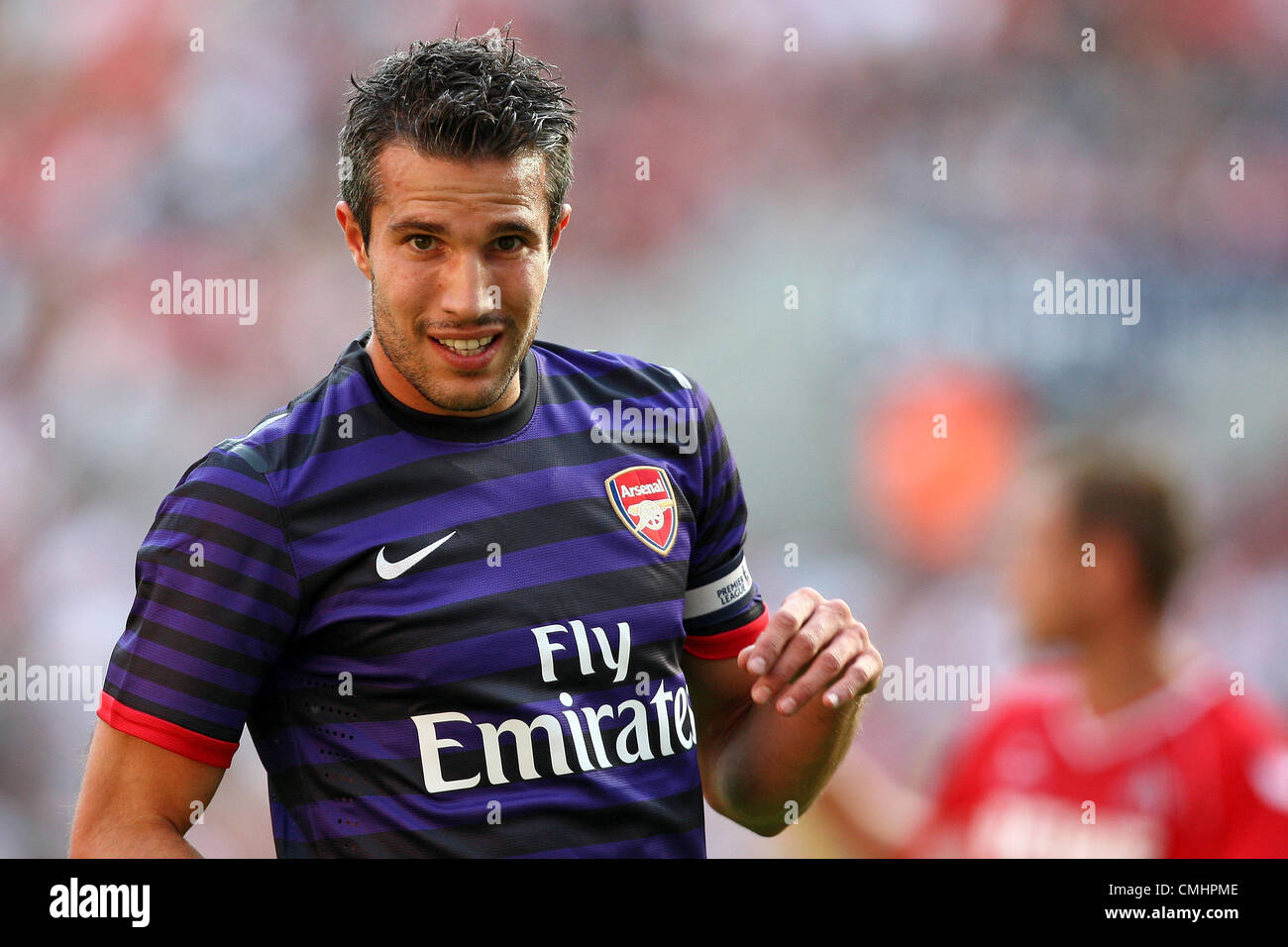 12.08.2012. Cologne, Germany.  Arsenal's Robin van Persie reacts during preseaon friendly match between FC Cologne Stock Photo