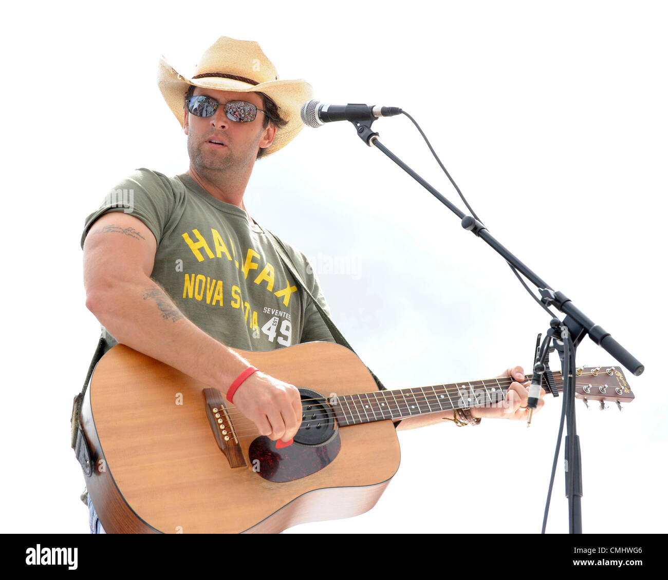 August 12, 2012 - Bowmanville, Ontario, Canada - Dean Brody surprise performance at the Boots and Heart Music Festival. - Stock Image