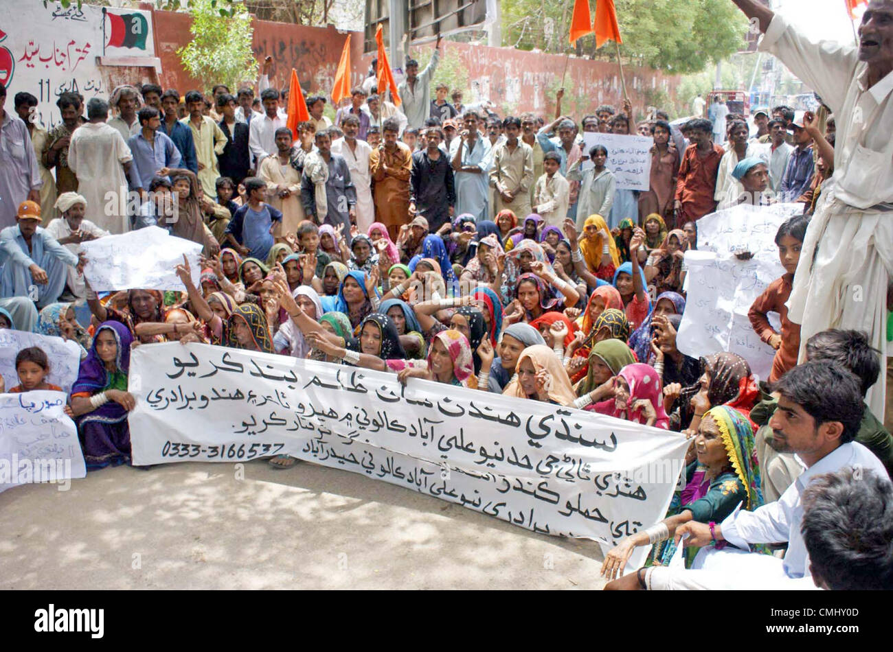 Residents of Aliabad chant slogans in favor of their  demands during a protest demonstration at Hyderabad press - Stock Image