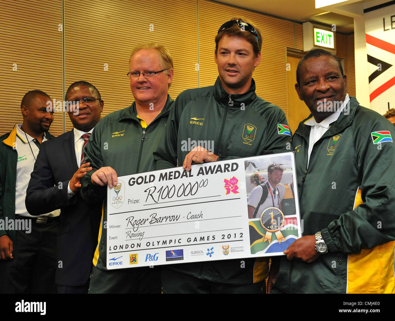 14th Aug 2012 Johannesburg, South Africa. Rowing coach Roger Barrow and assistant coach (Right) with Fikile Mdlalula - Stock Image
