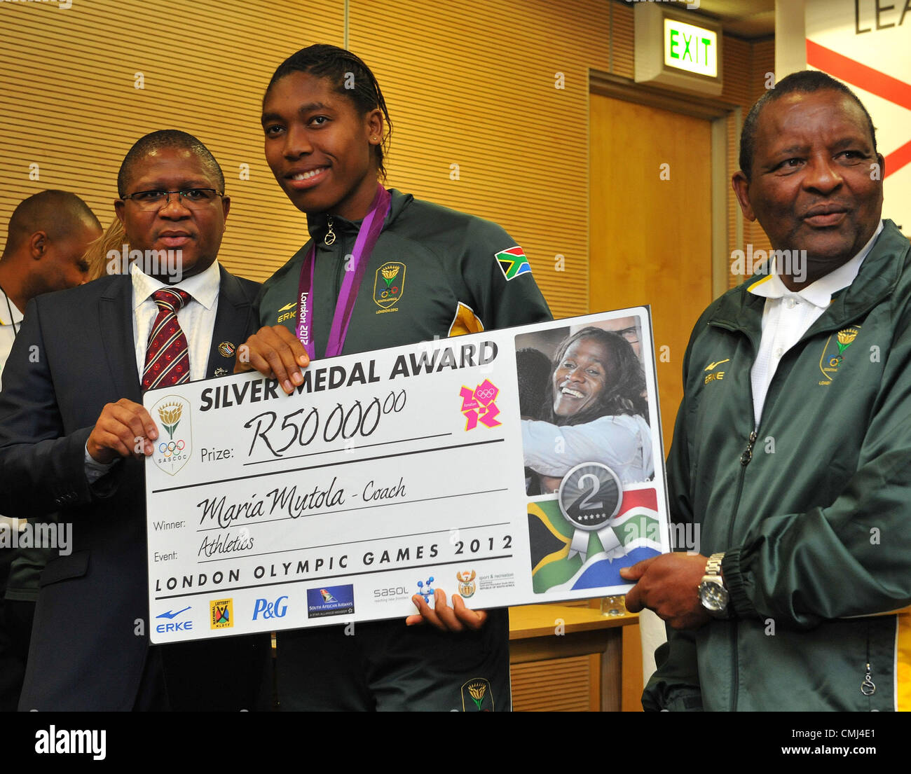 14th Aug 2012 Johannesburg, South Africa. Caster Semenya collects for her coach Maria Mutola from Fikile Mdlalula - Stock Image