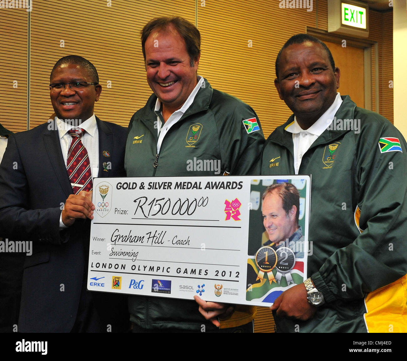 14th Aug 2012 Johannesburg, South Africa. Swiiming coach Graham Hill with Fikile Mdlalula and Gideon Sam during - Stock Image