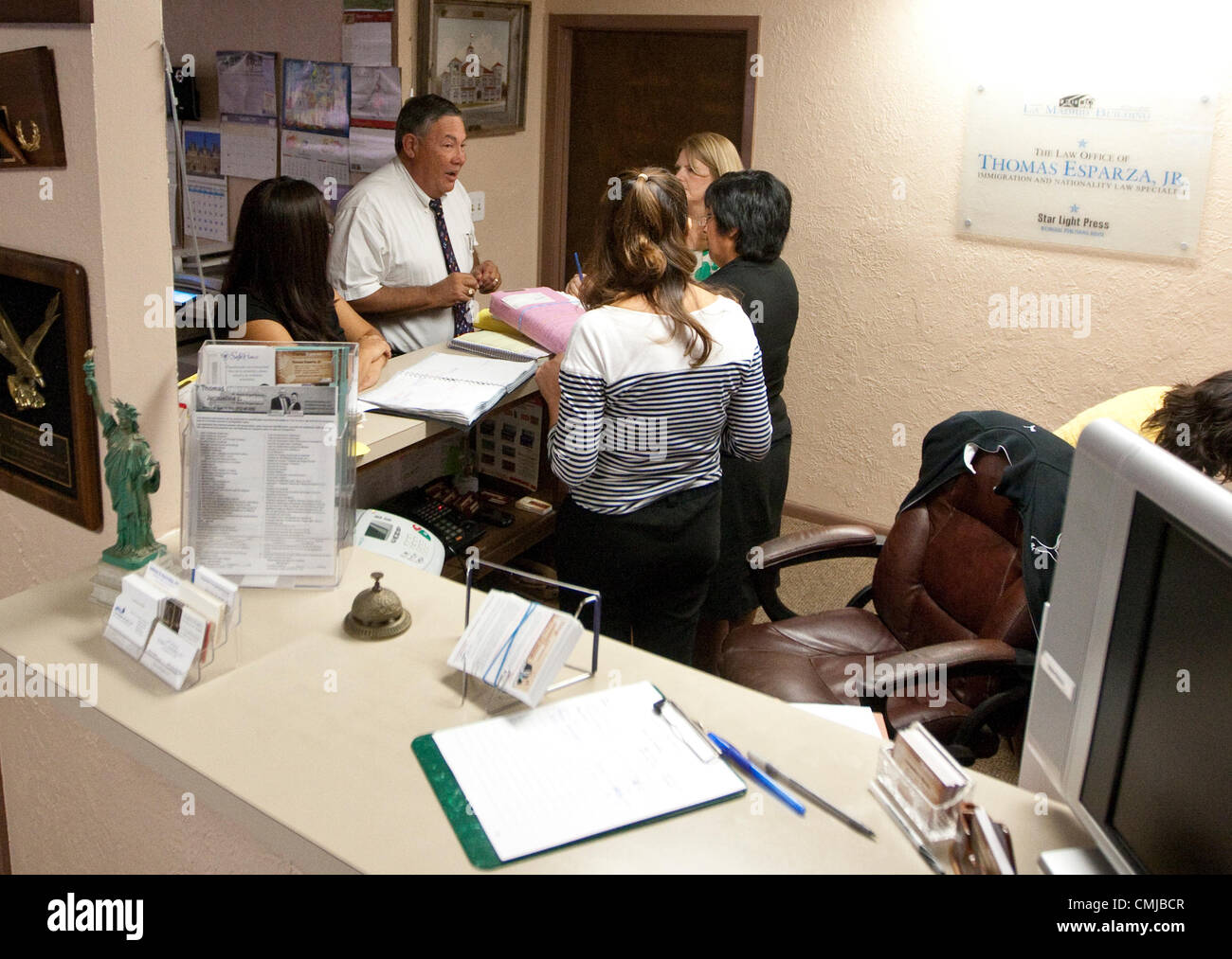 Busy immigration attorney meets with staff at his office in Austin, Texas - Stock Image