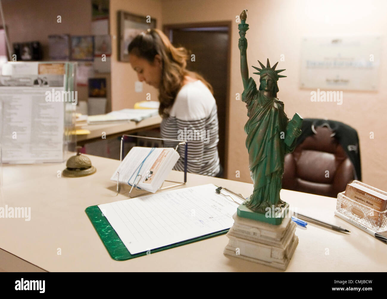 Miniature replica of Statue of Liberty sits on reception desk at immigration attorney's office in Austin, Texas - Stock Image