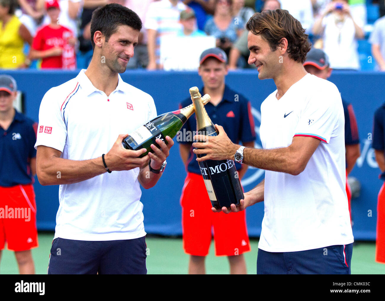 19 August 2012: Roger Federer (SUI) and Novak Djokovic (SRB) hold their commemorative bottles after the Men's Singles Stock Photo
