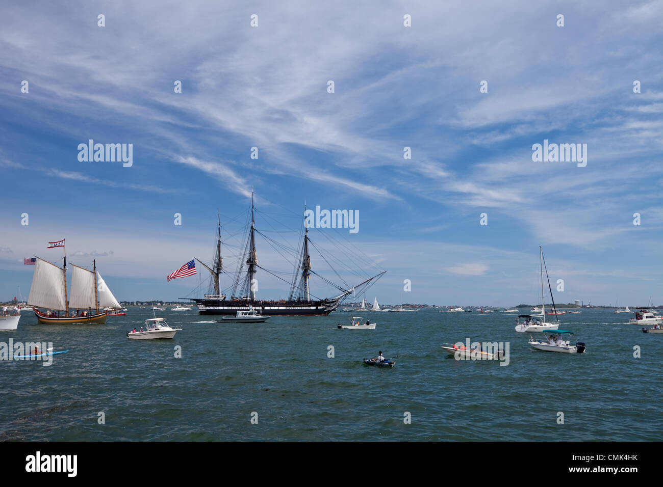 Pleasure boats gather to watch the USS Constitution head out for a commemorative sail in Boston Harbor, marking - Stock Image