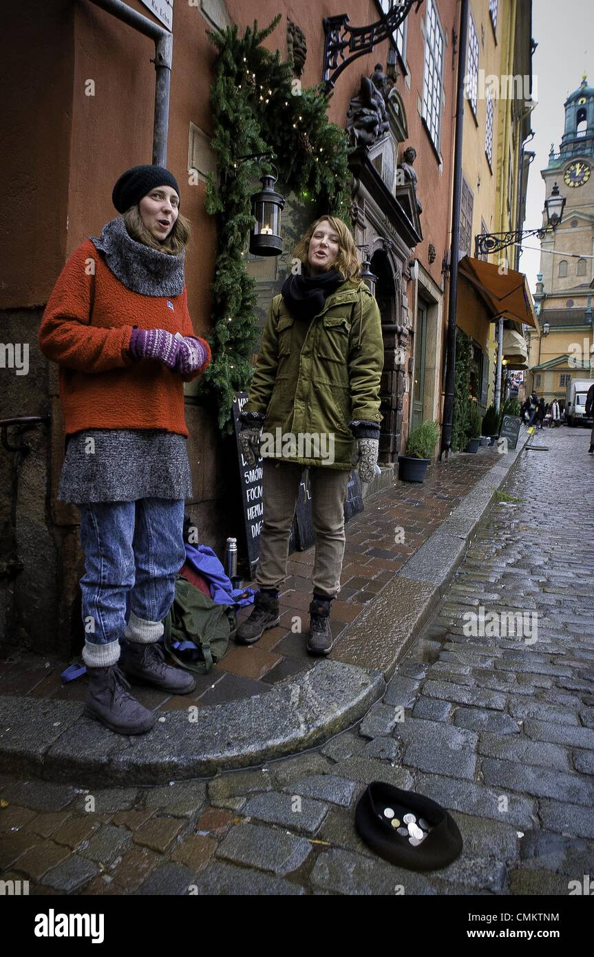 Stockholm, stockholm, sweden, . 18th Dec, 2011. SARA MOSSBERG (in red) and IDUN HANSEN, music students from Dalarna, - Stock Image