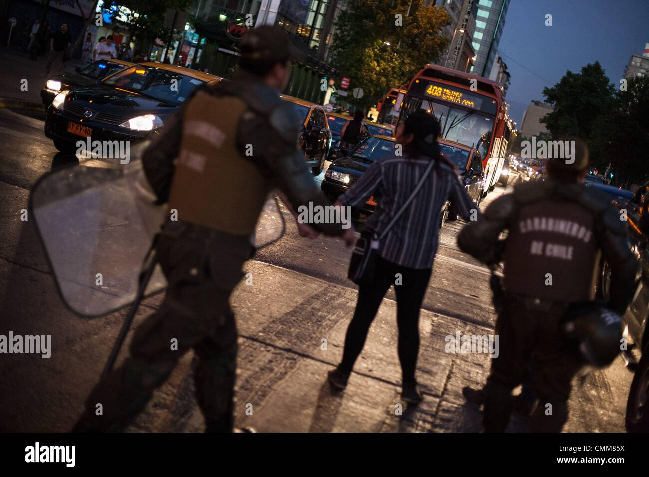Santiago Del Chile, Chile. 4th Nov, 2013. A group of protesters block Santiago's main street Alameda and is detained Stock Photo