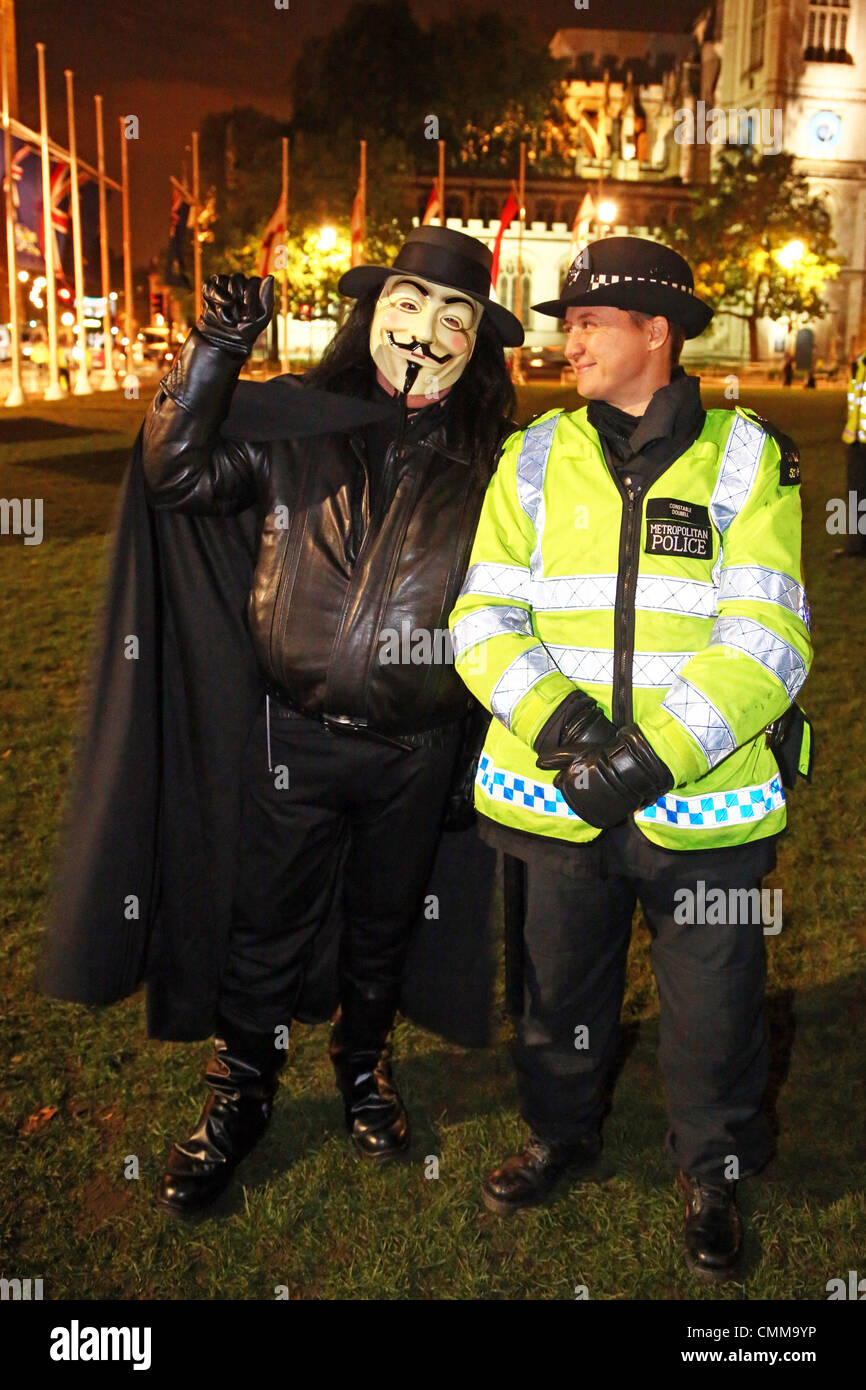 London, UK. 5th November 2013. Protestor in an Anonymous Mask with Police at the 5th November protests in Parliament - Stock Image