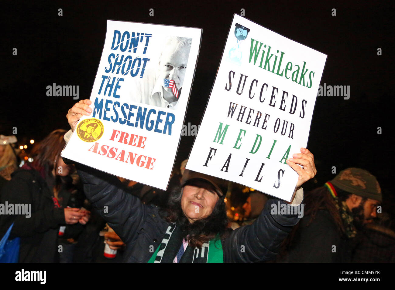 London, UK. 5th November 2013. Protestor with pro Wikileaks placards at the 5th November protests in Parliament - Stock Image