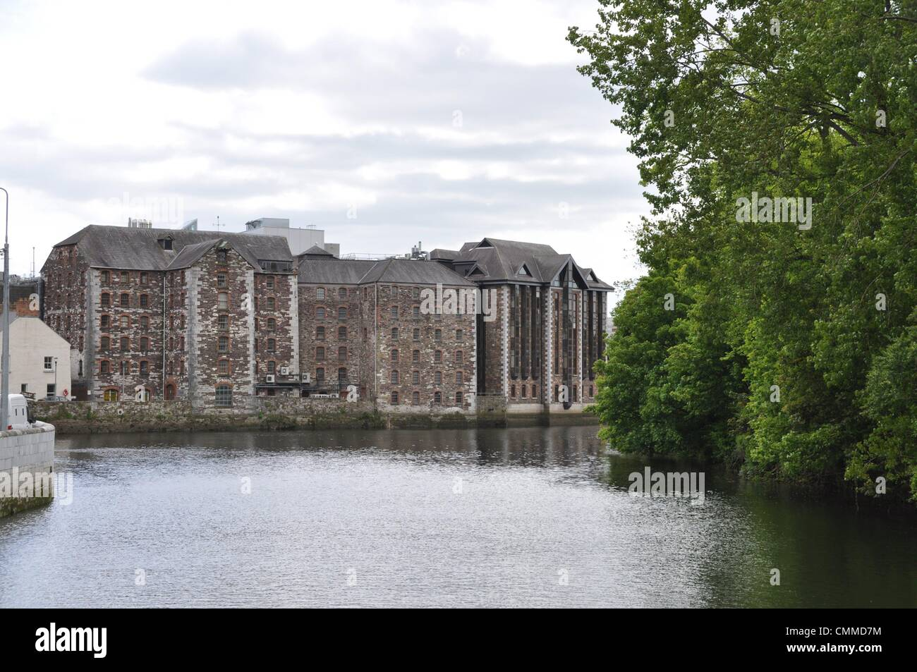 Old warehouses and partly restored industrial buildings at the River Lee in Cork, photo taken May 24, 2013. The - Stock Image