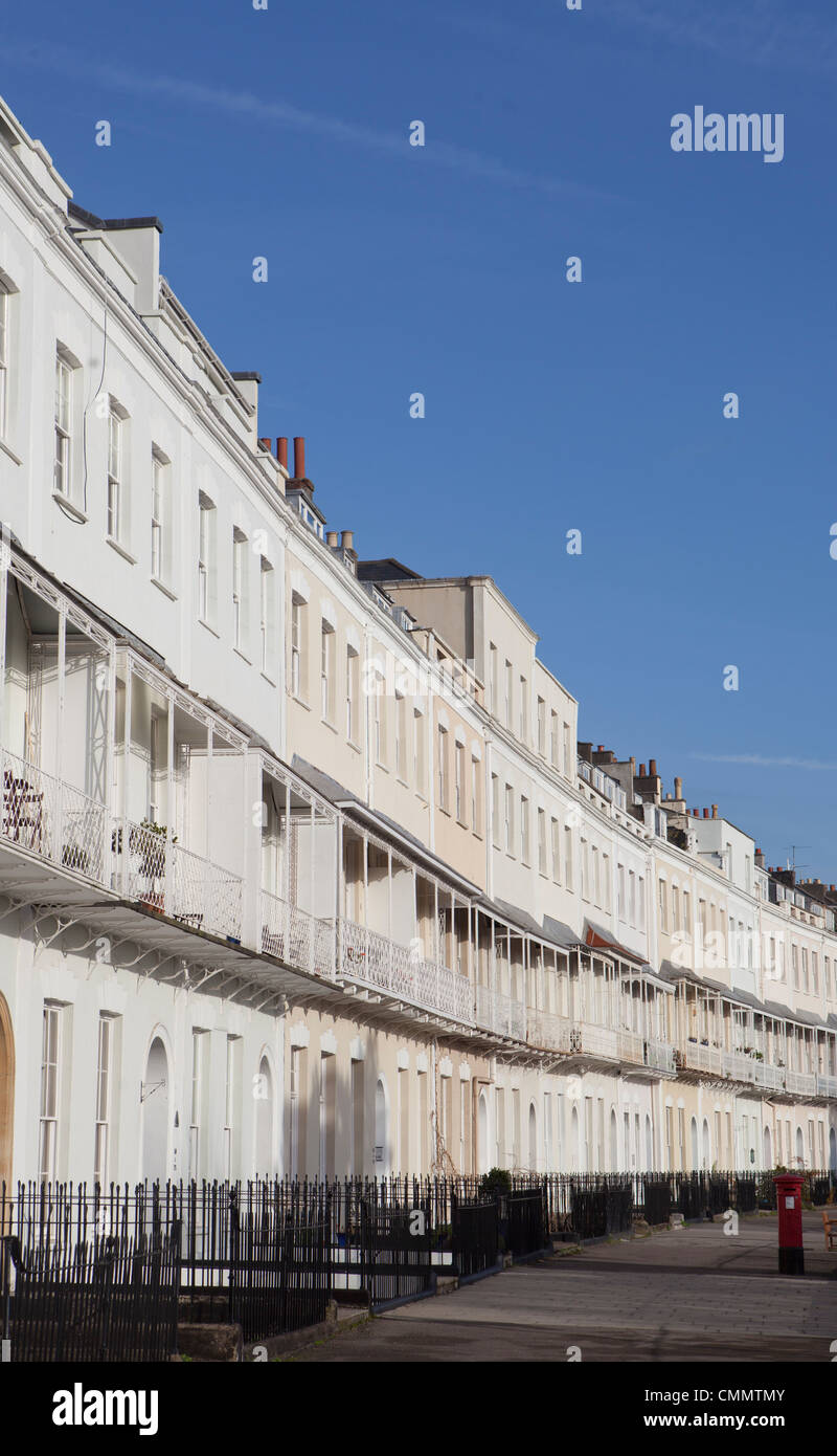 The Grade II listed row of terraced housing on the Royal York Crescent in Clifton, Bristol on a sunny day with a - Stock Image