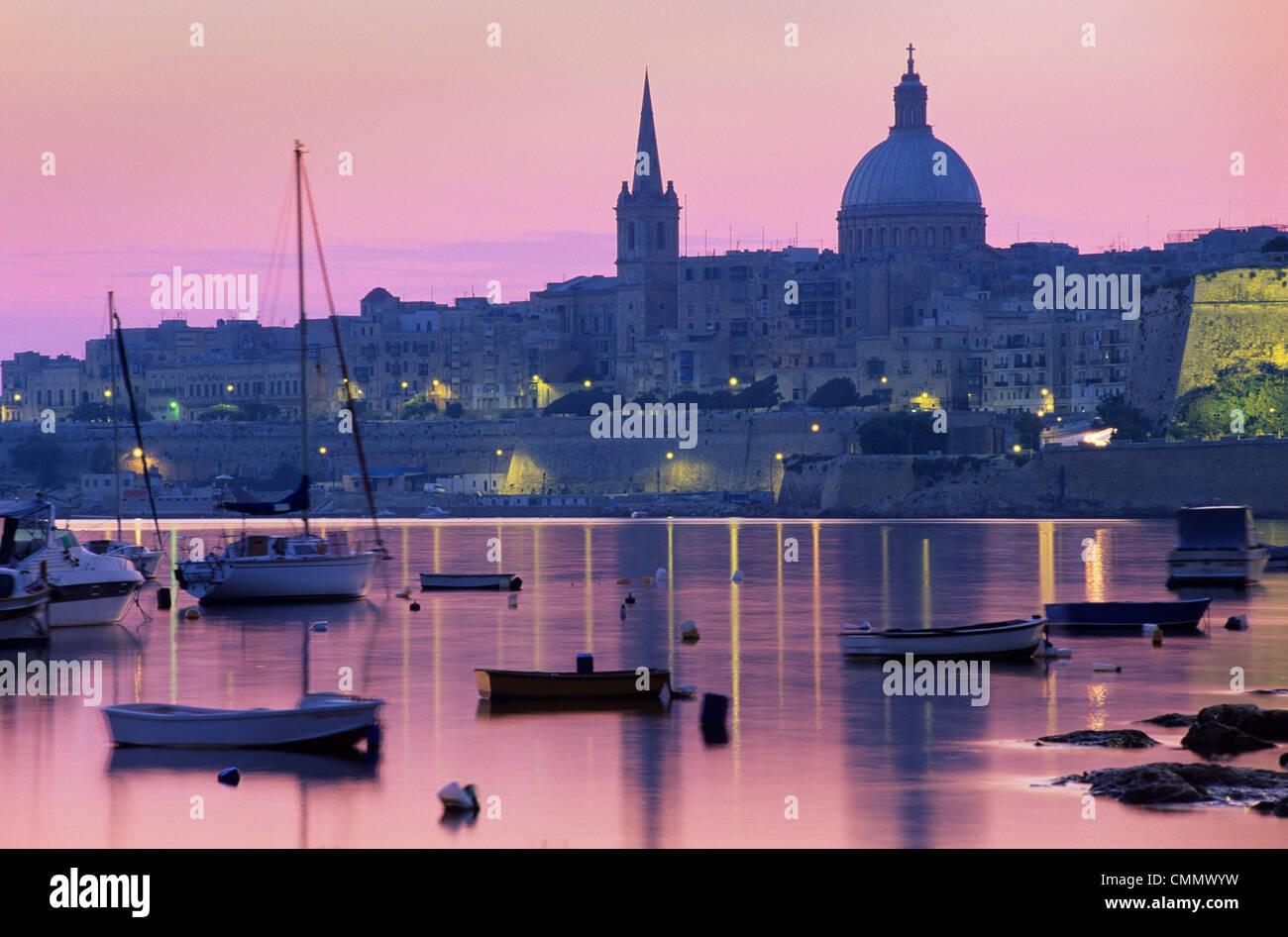 Sunrise over Msida Creek to Valletta with Dome of Carmelite Church, Valletta, Malta, Mediterranean, Europe - Stock Image