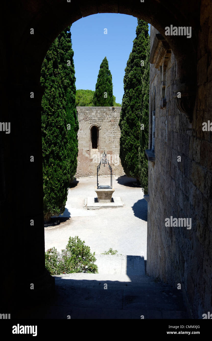 Rhodes. Greece. View of the Monastery courtyard well. Situated on the acropolis of Mt Filerimos on the verdant windswept - Stock Image